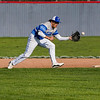 Tipton Blue Devils' Ethan Vawter (9) snags a ground ba;; during the first inning of a game between the Lewis Cass Kings and Tipton Blue Devils on Wednesday, April 14, 2021 in Walton.