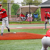 Logansport Berries pitcher Calryan Parmeter (8) tries to pick off a Harrison Raiders baserunner during the first inning of a game between the Logansport Berries and Harrison Raiders on Tuesday, May 4, 2021 in Logansport.