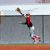A Logansport Berries outfielder catches a fly ball during the first game of a doubleheader between the Logansport Berries and LaPorte Slicers on Saturday, April 3, 2021 in Logansport.