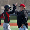 Logansport Berries shortstop Gavin Smith (23) fist bumps a coach as he rounds third base after hitting a walkoff home run in the first game of a doubleheader between the Logansport Berries and LaPorte Slicers on Saturday, April 3, 2021 in Logansport.