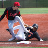 Logansport Berries infielder Brennan Goforth (11) tags LaPorte Slicers' Jayden Parkes (8) while falling during the first game of a doubleheader between the Logansport Berries and LaPorte Slicers on Saturday, April 3, 2021 in Logansport.