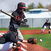 A pitch sails past a Logansport Berries batter during the first game of a doubleheader between the Logansport Berries and LaPorte Slicers on Saturday, April 3, 2021 in Logansport.