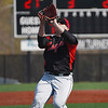Logansport Berries pitcher Mike Meadows (27) catches a fly ball during the the first game of a doubleheader between the Logansport Berries and LaPorte Slicers on Saturday, April 3, 2021 in Logansport.