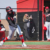 Logansport Berries shortstop Gavin Smith (23) hits a ground ball single to drive in runs during the fourth inning of the first of a doubleheader between the Logansport Berries and LaPorte Slicers on Saturday, April 3, 2021 in Logansport.