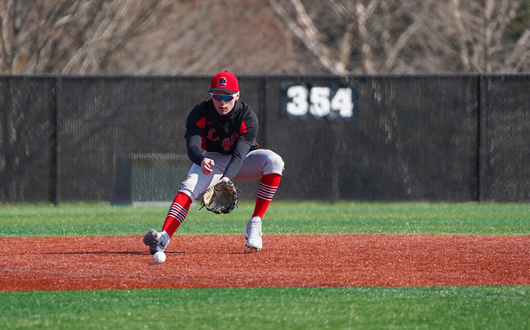 Logansport Berries shortstop Gavin Smith (23) fields a ground ball during the first game of a doubleheader between the Logansport Berries and LaPorte Slicers on Saturday, April 3, 2021 in Logansport.