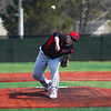 Logansport Berries pitcher Mike Meadows (27) throws a pitch during the first game of a doubleheader between the Logansport Berries and LaPorte Slicers on Saturday, April 3, 2021 in Logansport.