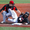 Logansport Berries infielder Brennan Goforth (11) tags LaPorte Slicers' Jayden Parkes (8) as Parkes tries to steal third base during the first game of a doubleheader between the Logansport Berries and LaPorte Slicers on Saturday, April 3, 2021 in Logansport.