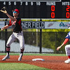 Logansport Berries shortstop Gavin Smith (23) catches the ball as Lewis Cass Kings' David Woolever (27) stops his run to second base during the first inning of a game between the Logansport Berries and Lewis Cass Kings on Thursday, May 13, 2021 in Logansport.