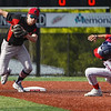 Logansport Berries shortstop Gavin Smith (23) chases Lewis Cass Kings' David Woolever (27) during the first inning of a game between the Logansport Berries and Lewis Cass Kings on Thursday, May 13, 2021 in Logansport.