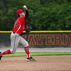 Logansport Berries shortstop Gavin Smith (23) throws to first base during the second inning of the NCC championship between the McCutcheon Mavericks and Logansport Berries on Saturday, May 15, 2021 in Lafayette.