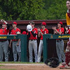 Logansport Berries players celebrate from the dugout during the first inning of the NCC championship between the McCutcheon Mavericks and Logansport Berries on Saturday, May 15, 2021 in Lafayette.