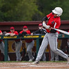 Logansport Berries infielder Tristan Kitchel (12) hits the ball during the first inning of the NCC championship between the McCutcheon Mavericks and Logansport Berries on Saturday, May 15, 2021 in Lafayette.