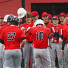 Logansport Berries players celebrate as catcher Ethan Denny (13) returns to the dugout after a three run home run during the first inning of a game between the Logansport Berries and Peru Tigers on Friday, April 23, 2021 in Logansport.