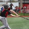 Logansport Berries pitcher Eli Starkey (28) hits a ground ball during the fourth inning of a game between the Logansport Berries and Twin Lakes Indians on Saturday, April 10, 2021 in Logansport.