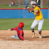 Pioneer Panthers infielder Caleb Sweet (23) tries to turn a double play during the second inning of a game between the Pioneer Panthers and Caston Comets on Thursday, April 29, 2021 in Fulton.
