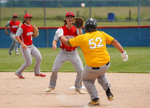 Southwood Knights infielder Joey Bland (16) goes to catch the ball as Pioneer Panthers infielder Brenton Gaumer (52) gets caught in a rundown during the second inning of the sectional championship between the Southwood Knights and Pioneer Panthers on Monday, May 31, 2021 in Fulton.