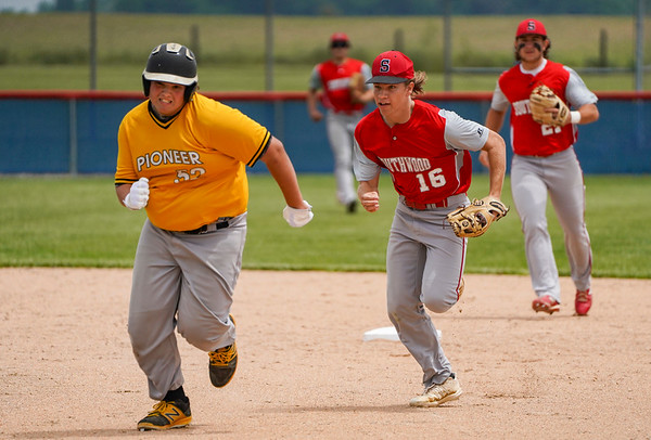 Southwood Knights infielder Joey Bland (16) chases Pioneer Panthers infielder Brenton Gaumer (52) during the second inning of the sectional championship between the Southwood Knights and Pioneer Panthers on Monday, May 31, 2021 in Fulton.