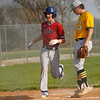 Tri-County Cavaliers infielder Koby Bahler (4) steps on home after a wild pitch by Pioneer Panthers pitcher Caleb Sweet (23) during the second inning of a game between the Tri-County Cavaliers and Pioneer Panthers on Tuesday, April 6, 2021 in Royal Center.