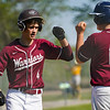 Winamac Warriors infielder Caleb Good (4) fist bumps infielder Caleb Seymour (16) after a home run during the first inning of a game between the Pioneer Panthers and Winamac Warriors on Friday, May 14, 2021 in Royal Center.