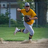 Pioneer Panthers infielder Caleb Sweet (23) throws the ball to first after grabbing a grounder during the third inning of a game between the Pioneer Panthers and Winamac Warriors on Friday, May 14, 2021 in Royal Center.