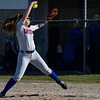 Caston Comets pitcher Kinzie Mollenkopf (3) winds up for a pitch during the season opener between the Caston Comets and Carroll Cougars on Friday, April 2, 2021 in Fulton.