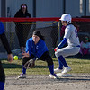 Caston Comets infielder Isabel Scales (10) steps on third base as a late throw comes in during the season opener between the Caston Comets and Carroll Cougars on Friday, April 2, 2021 in Fulton.