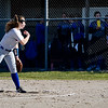 Caston Comets pitcher Kinzie Mollenkopf (3) throws a pitch during the season opener between the Caston Comets and Carroll Cougars on Friday, April 2, 2021 in Fulton.
