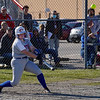 Caston Comets infielder Rebekah Milburn (13) pops the ball up during the season opener between the Caston Comets and Carroll Cougars on Friday, April 2, 2021 in Fulton.
