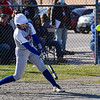 Caston Comets pitcher Addison Zimpleman (9) hits a homer during the season opener between the Caston Comets and Carroll Cougars on Friday, April 2, 2021 in Fulton.