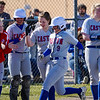 Caston Comets pitcher Addison Zimpleman (9) touches home plate after hitting a homer during the season opener between the Caston Comets and Carroll Cougars on Friday, April 2, 2021 in Fulton.