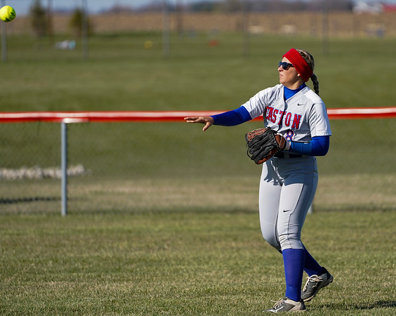 Caston Comets outfielder Layne Oliver (8) throws the ball during the season opener between the Caston Comets and Carroll Cougars on Friday, April 2, 2021 in Fulton.