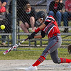 Logansport Berries first baseman Addison Guire (27) hits the ball during the second inning of a game between the Logansport Berries and Caston Comets on Monday, April 5, 2021 in Fulton.