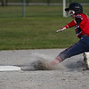Logansport Berries outfielder Justyce Rohrabaugh (16) slides to second base during the first inning of a game between the Logansport Berries and Caston Comets on Monday, April 5, 2021 in Fulton.