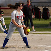 Caston Comets pitcher Kinzie Mollenkopf (3) throws a pitch during the second inning of a game between the Logansport Berries and Caston Comets on Monday, April 5, 2021 in Fulton.