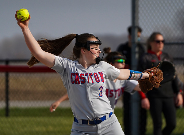 Caston Comets pitcher Kinzie Mollenkopf (3) throws a pitch during the first inning of a game between the Logansport Berries and Caston Comets on Monday, April 5, 2021 in Fulton.