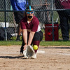 Winamac Warriors' Emma Goodman (20) catches a throw at first base during the fourth inning of a game between the Caston Comets and Winamac Warriors on Tuesday, May 11, 2021 in Winamac.