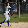 Caston Comets pitcher Kinzie Mollenkopf (3) throws to first base during the second inning of a game between the Caston Comets and Winamac Warriors on Tuesday, May 11, 2021 in Winamac.
