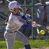Caston Comets infielder Isabel Scales (10) hits a single during the second inning of a game between the Caston Comets and Winamac Warriors on Tuesday, May 11, 2021 in Winamac.