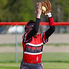 Logansport Berries third baseman Kendra Sutton (6) makes a catch during the first inning of a game between the Logansport Berries and Lewis Cass Kings on Wednesday, May 12, 2021 in Walton.