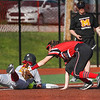 Logansport Berries third baseman Kendra Sutton (6) tries to apply a tag but loses the ball during the fourth inning of a game between the Logansport Berries and McCutcheon Mavericks on Tuesday, April 27, 2021 in Logansport.