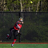 Logansport Berries outfielder Ashlyn Berkshire (14) throws the ballin during the first inning of a game between the Logansport Berries and McCutcheon Mavericks on Tuesday, April 27, 2021 in Logansport.