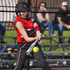 Logansport Berries infielder Abby Henderson (20) makes contact on a  pitch during the fourth inning of a game between the Logansport Berries and McCutcheon Mavericks on Tuesday, April 27, 2021 in Logansport.