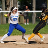 Boone Grove Wolves infielder Katelyne Allen (23) throws to first base in a double play attempt during the first inning of the sectional semifinal between the Pioneer Panthers and Boone Grove Wolves on Wednesday, May 26, 2021 in Winamac.