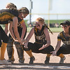 Pioneer Panthers infielder Brooklyn Borges (6) low fives teammates during player introductions before the semistate championship game between the Fairfield Falcons and Pioneer Panthers on Saturday, June 5, 2021 in Chalmers.