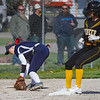 Pioneer Panthers pitcher Hailey Gotshall (15) gets to third base after the Lewis Cass Kings fumble a throw during the first inning of a game between the Pioneer Panthers and Lewis Cass Kings on Thursday, April 22, 2021 in Royal Center.