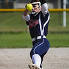 Lewis Cass Kings' Madi Dormer (30) winds up a pitch during the first inning of a game between the Pioneer Panthers and Lewis Cass Kings on Thursday, April 22, 2021 in Royal Center.