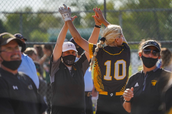 Pioneer Panthers infielder Crystabelle Blickenstaff (10) high fives coach Gabby Thomas before the regional championship between the Wheeler Bearcats and Pioneer Panthers on Tuesday, June 1, 2021 in Valparaiso.