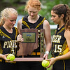 Pioneer Panthers catcher Mackenzie Walker (3), infielder Madison Blickenstaff (14) and infielder Hailey Gotshall (15) hold the sectional trophy and game balls after defeating the Winamac Warriors on Thursday, May 27, 2021 in Winamac.