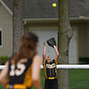 Pioneer Panthers outfielder Adeline Cripe (1) catches a ball at the fence during the first inning of the sectional final between the Pioneer Panthers and Winamac Warriors on Thursday, May 27, 2021 in Winamac.