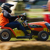 A racer makes a turn during the U.S. Lawn Mower Racing Association governed prepared singles heat at Plank Hill Park in Twelve Mile on Friday, July 2, 2021.